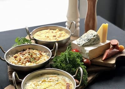 Trio of Macaroni and Cheeses (Cheddar & Chorizo, Brie & Chives, Blue Cheese, Apple & Walnut)